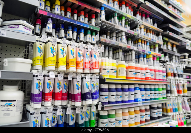 Art supplies tubes of acrylic paint for sale inside a hobby craft store, UK. - Stock Image