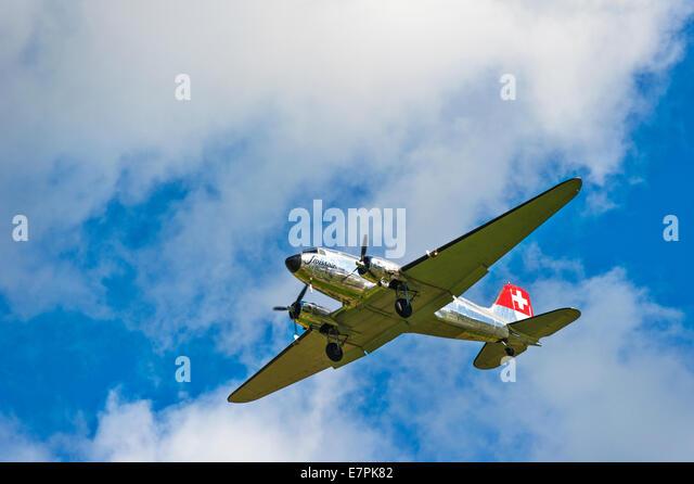 A Douglas DC-3 (Dakota) of Swissair, coming in to land - Stock Image