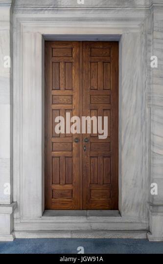 Wooden engraved door on white, marble wall, Nuruosmaniye Mosque, Istanbul, Turkey, Istanbul, Turkey - Stock Image