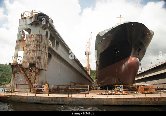 cargo ship in dry dock on west coast of  Caribbean island of Trinidad in Trinidad and Tobago - Stock Image