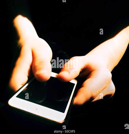 Teenager using his smartphone - Stock Image