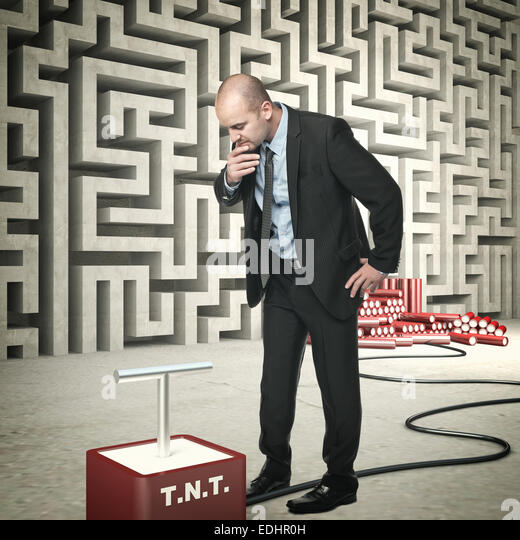 businessman tnt and abstract wall maze - Stock Image