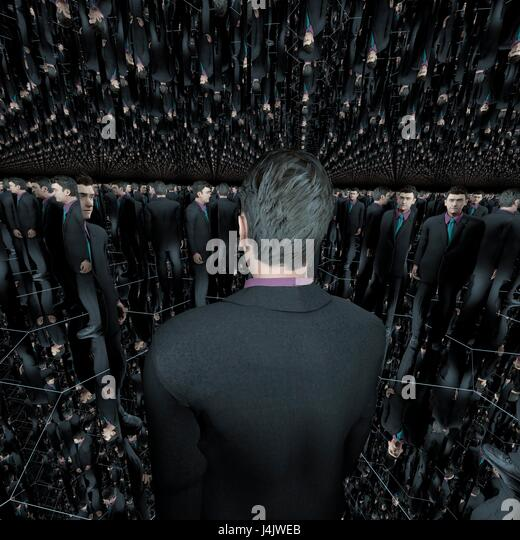 A man stands in a small hexagonal enclosure, where all six walls, ceiling and floor are mirrors. Computer artwork. - Stock-Bilder