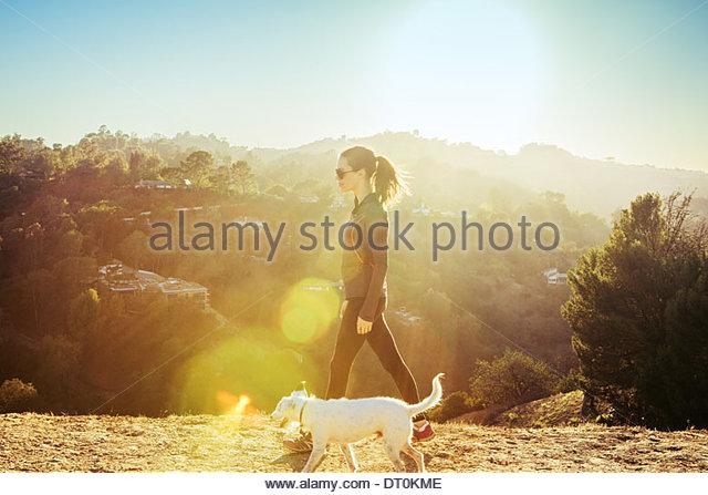 USA, California, Los Angeles, Woman walking dog - Stock Image
