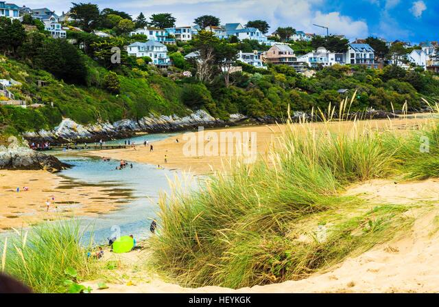 A views across the sand dunes at Crantock Beach and the Gannel River estuary in Newquay, Cornwall, UK - Stock Image