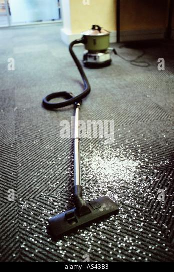 Hoover and messy carpet - Stock-Bilder