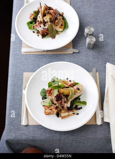 Plate of pheasant with parsnip salad - Stock Image