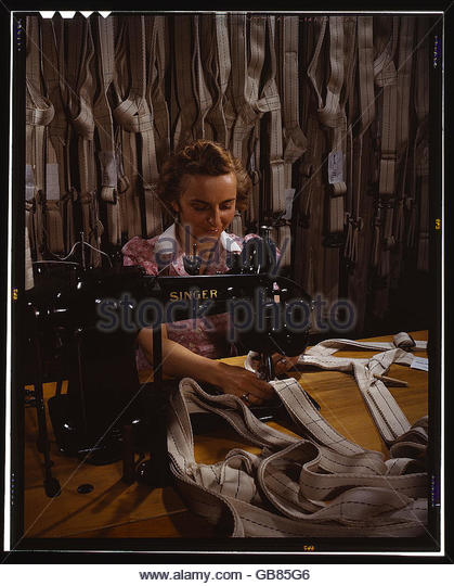 Making harnesses, Mary Saverick stitching, Pioneer Parachute Company Mills, Manchester, Conn. - Stock Image