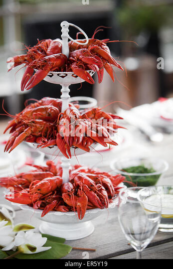 Having a summer party with lots of crayfish - Stock Image