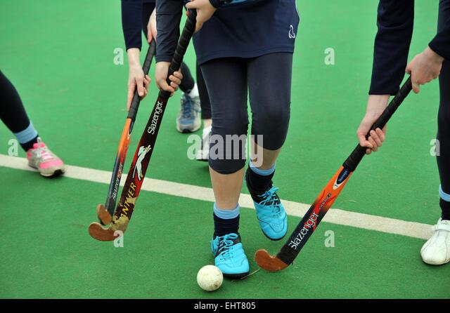 Girls hockey at Secondary school - Stock Image