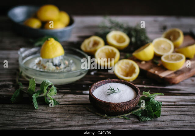 Ingredients for mint and rosemary lemonade with vanilla are photographed from the front view. - Stock Image