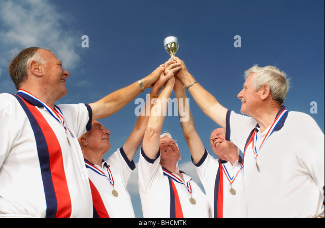 men and trophy - Stock Image