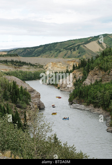 View of a group of rafters as seen from the Alaska Railroad, Nenana River Canyon north of Denali National Park, - Stock Image