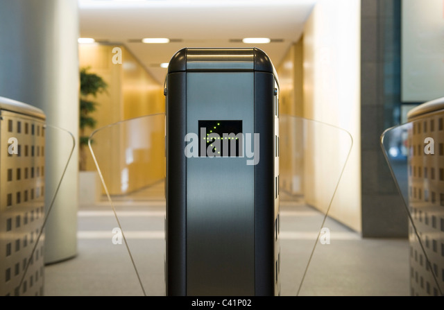 Turnstile in office building lobby - Stock-Bilder