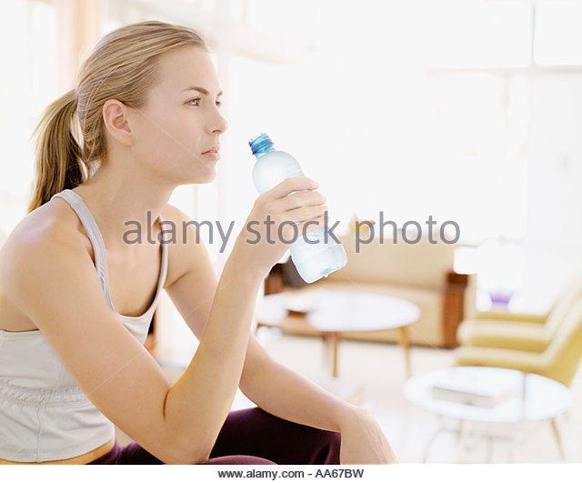 Woman with bottled water - Stock Image