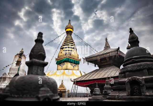 Swayambhunath stupa at overcast cloudy sky in Kathmandu, Nepal - Stock Image
