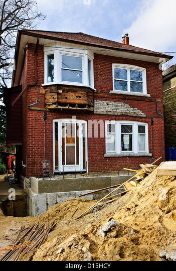 Exterior of a house under renovation at construction site - Stock Image
