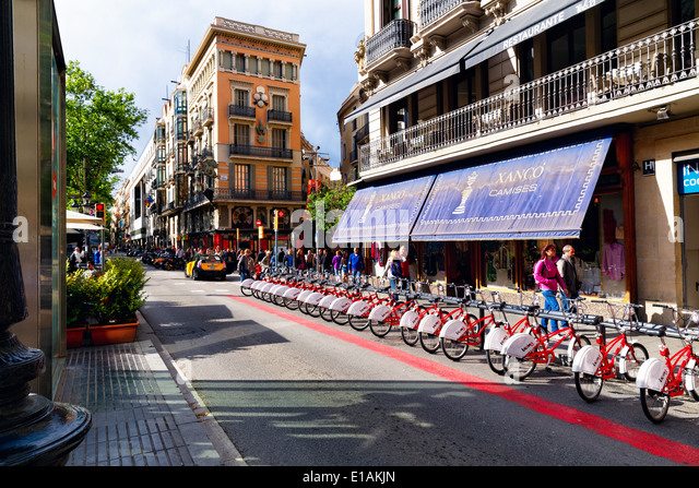 Bicycles For Rent on La Rambla, Barcelona, Catalonia, Spain - Stock Image