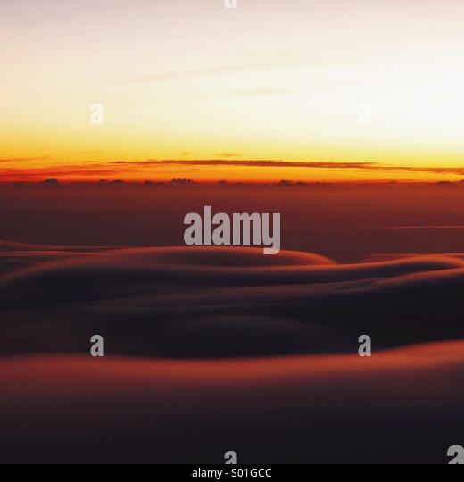Sunrise on the way up of Mount Rinjani, Indonesia. - Stock Image