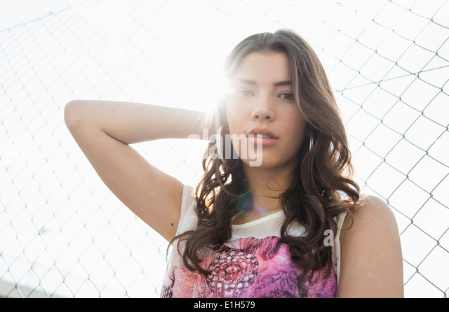 Young brunette woman with hand in hair - Stock-Bilder