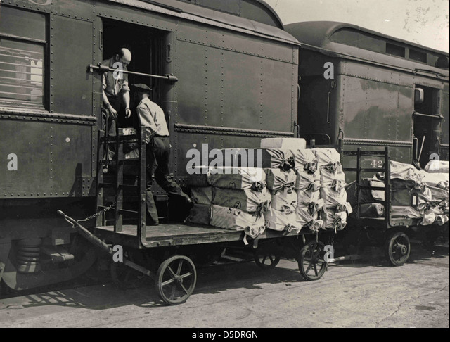 Loading Mail onto Railway Post Office Car - Stock Image