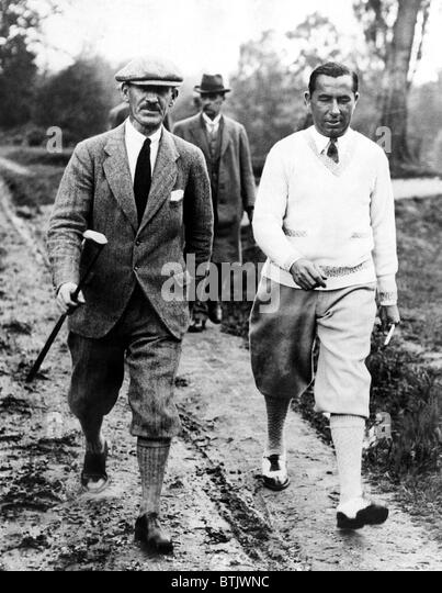Golfers Abe Mitchell Walter Hagen at the golf course at Weybridge, England during a match.  June 25, 1926. Courtesy: - Stock Image