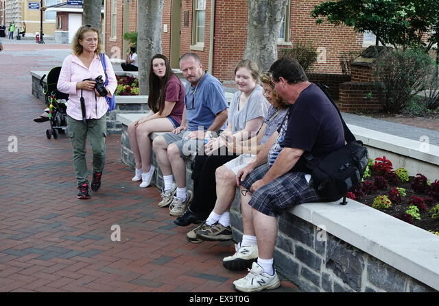 Visitors taking a break at the Old Town pedestrian mall, Winchester, Virginia - Stock Image
