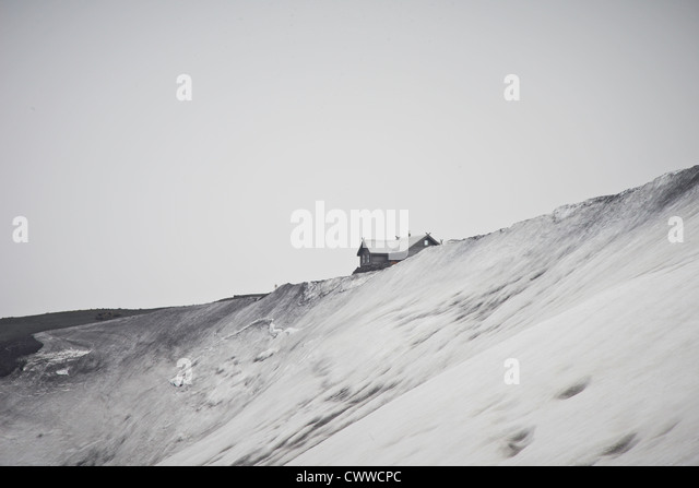 House built on snowy hilltop - Stock Image