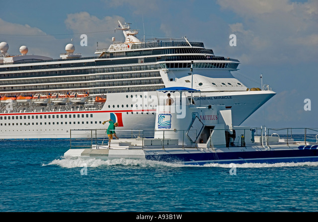 George Town Grand Cayman Carnival Miracle cruise ship Nautilus semisubmersible - Stock Image