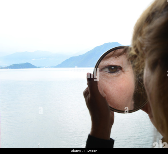 Magnifying mirror for woman with eye makeup magnify - Stock Image
