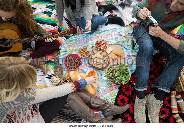 Overhead view friends enjoying picnic - Stock Image