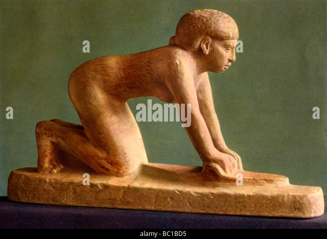 A woman grinding corn, c2650 BC (1936). - Stock Image