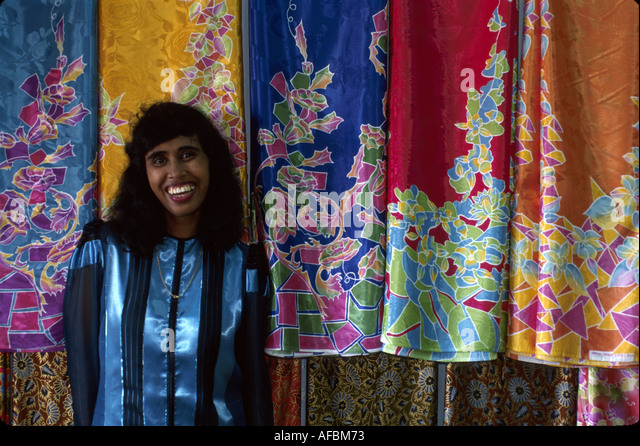 Malaysia Borneo Sarawak Kuching Main Bazaar Road Malay Indian female batik cloth display - Stock Image