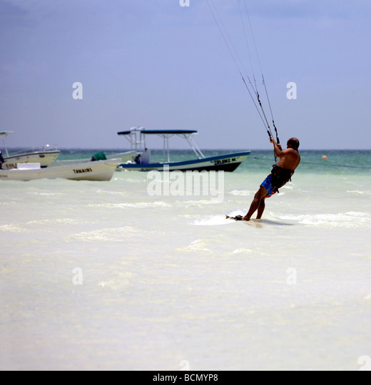 Man kite surfing on Holbox island, Quintana Roo, Yucatán Peninsula, Mexico, a unique Mexican destination in - Stock Image
