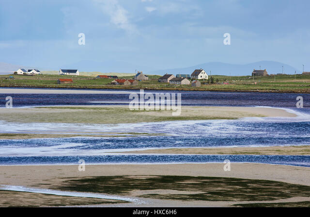 Sunny view fishing village and water, Oronsay, North Uist, Outer Hebrides - Stock Image