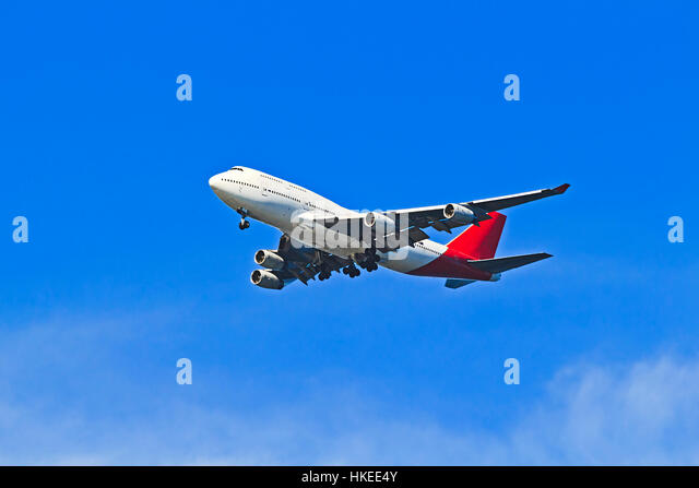 Huge double-decker airplane midair in a blue clear sky elevating from airport take-off in Australia carrying passengers - Stock Image