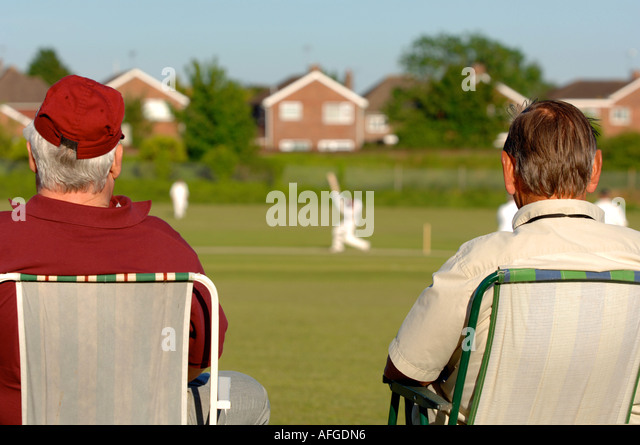 Cricket, spectators watch a village cricket match, Briatin UK - Stock Image
