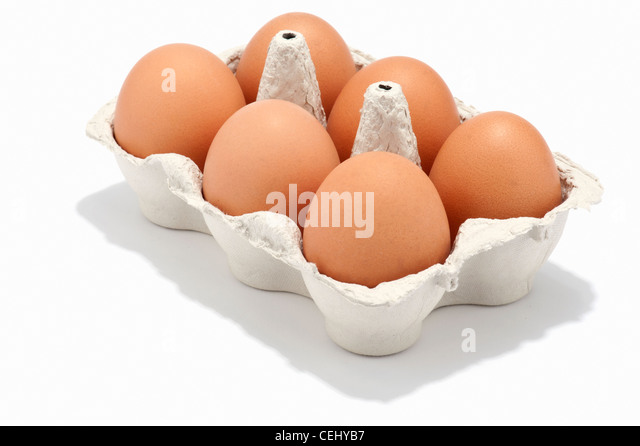 6 eggs in an egg box - Stock Image