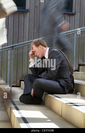 Time lapse view of depressed businessman - Stock Image