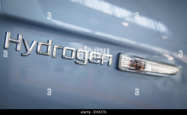 Environmental energy image of the sign on the side of a modern hydrogen car - Stock Image