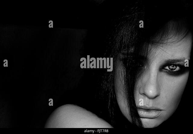 Portrait Of Fashion Model Against Black Background - Stock Image