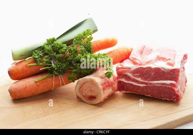 Beef broth ingredients on chopping board, close up - Stock Image