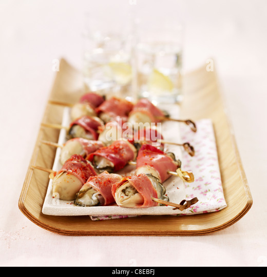 Oyster and Bayonne ham brochettes - Stock Image