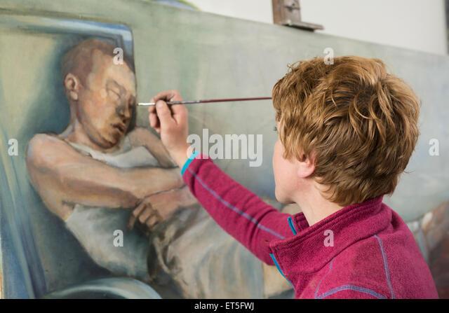 Female artist painting, Bavaria, Germany - Stock-Bilder
