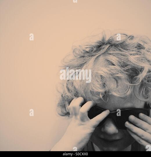 Portrait of toddler wearing sunglasses - Stock Image