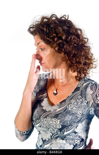 The gesture of touching and slightly rubbing of nose indicates rejection doubt and lying in this woman in terms - Stock Image