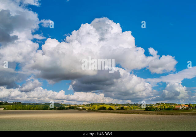 Summer sky with Cumulus and Cumulonimbus Calvus rain clouds - France. - Stock Image