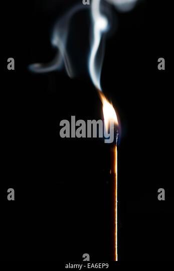 Match stick with smoke on black background - Stock-Bilder