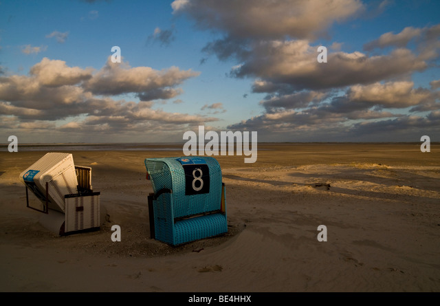 Beach chairs, evening mood, Amrum, Schleswig-Holstein, Germany, Europe - Stock Image