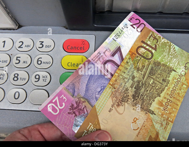 Scots Pound Sterling Notes being pulled from a Clydesdale bank ATM cash dispensing machine , Scotland UK - Stock Image